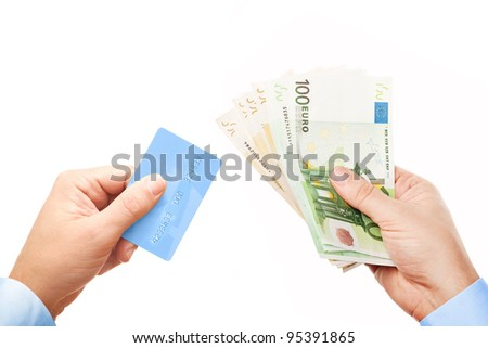"""Concept """"Cash or Card?"""" - the view down on businessman's hands holding plastic credit card and bunch of money (various Euro (Eur) banknotes), isolated over white background - stock photo"""