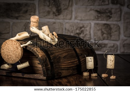 Concept Children on a sliding board, wine cork figures - stock photo