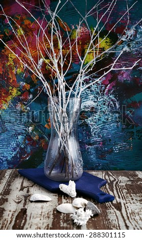 concept composition of white colored branches on the artbackground with seashells on the old wooden table - stock photo