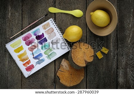 concept composition of yellow things on wooden background - stock photo