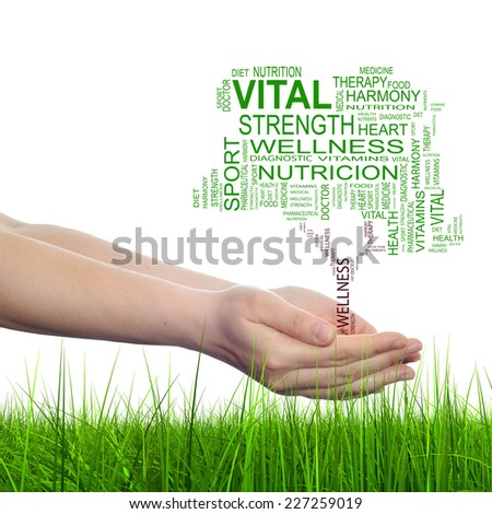 Concept conceptual green text word cloud tagcloud as tree in man or woman hand isolated on white background and grass, metaphor to health, nutrition, diet, body, energy, medical, sport, heart science - stock photo