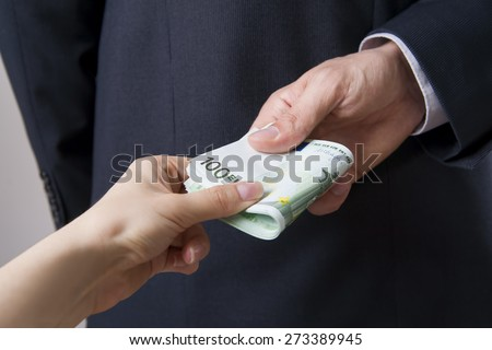 Concept - corruption. Giving a bribe. Money in hand - stock photo