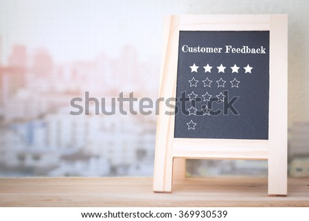 Concept Customer Feedback message on wood boards - stock photo