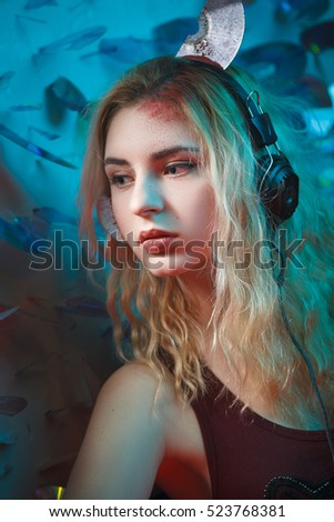 Concept: deadly music, sound kills. Beautiful young woman in headphones with bloody parts of cd sticking out of her head. Accident/murder victim. Undead.