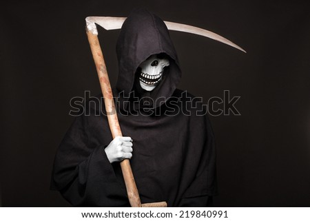 Concept: death. Studio portrait on black background - stock photo