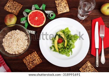 Concept diet food. A variation on the theme of diet with grapefruit and vegetable salad with lettuce and avocado. Organic food - stock photo