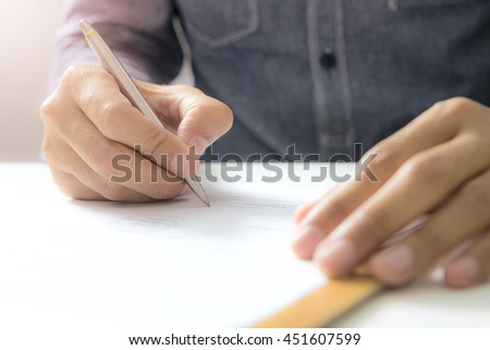 Concept Document sign off - Smart businessman signing document. - stock photo