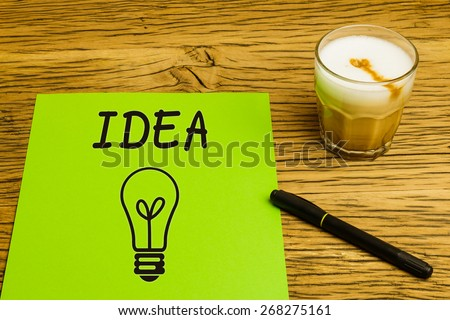 Concept empty green page, idea, think creative, business solution, new design. Marker and coffee on oak desk. - stock photo