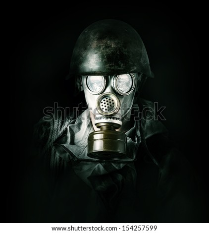 Concept. environmental protection. Man in gas mask  - stock photo