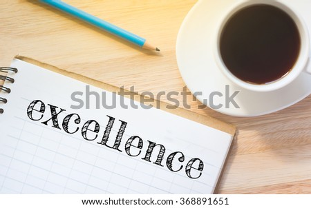 Concept excellence message on book. A pencil and a glass coffee table.Vintage tone. - stock photo