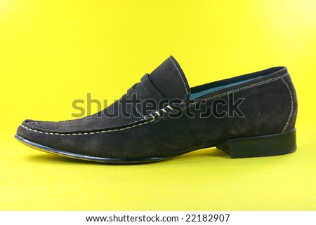 concept fashion clothing shoes in yellow background