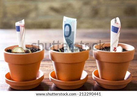 concept financial planning and investment with euro banknotes and coins - stock photo