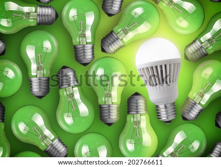 Concept for big idea. Glowing LED bulb on green background - stock photo