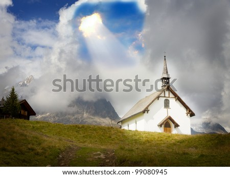 concept for christianity, god, belief, relief and trust: white plain mountain chapel at Belalp near Aletsch glacier in a ray of light, Valais, Switzerland