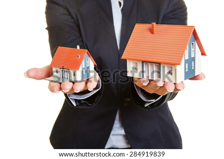 Concept for comparision of real estate houses pricing - stock photo