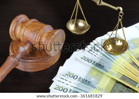 Concept For Corruption, Bankruptcy, Bail, Crime, Bribing, Fraud. Judges Gavel, Scale Of Justice And Euro Cash On The Rough Black Wooden Textured Table Background. - stock photo