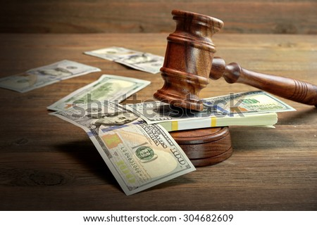 Concept For Corruption, Bankruptcy Court, Bail, Crime, Bribing, Fraud, Auction Bidding. Judges or Auctioneer Gavel, Soundboard And Bundle Of Dollar Cash On The Rough Wooden Textured Table Background. - stock photo