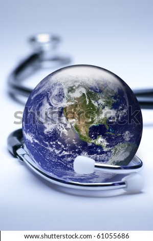 Concept for global medicine. Shallow  focus on globe. Largely blue tones. Globe public domain courtesy http://visibleearth.nasa.gov/