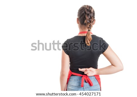 Concept for good luck or dishonesty with female employee holding fingers crossed behind her back isolated on white with advertising area - stock photo