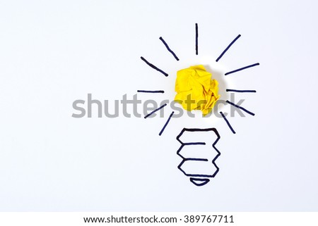 Concept for innovation, creativity and inspiration. Sketch of a light bulb with a paper ball - stock photo