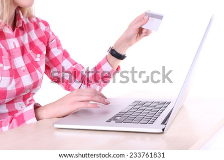 Concept for Internet shopping: hands with laptop and credit card - stock photo