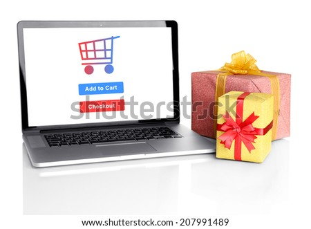Concept for Internet shopping: laptop and gifts isolated on white