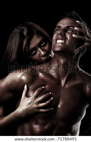 Concept for painful sin. Young woman catching and possessing a young man in her spell. Concept for painful sin. - stock photo