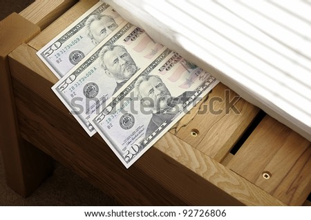 Concept for saving money by stashing it under the mattress.