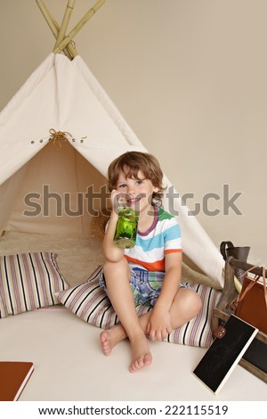 Concept for science education through indoor play with a teepee tent for school and preschool aged children - stock photo