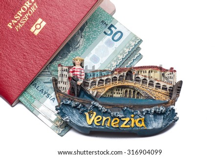 Concept for travel to venice,Red passport with banknote malaysia and magnet fridge - stock photo