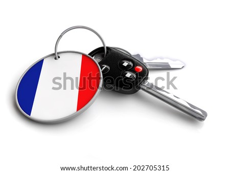 Concept for vehicles made in a specific country. Car industry concept of keys with country flag as key ring. Cars made in France. - stock photo