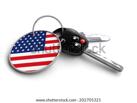 Concept for vehicles made in a specific country. Car industry concept of keys with country flag as key ring. Cars made in USA (American made) - stock photo