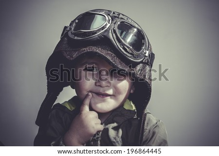 concept, fun and funny child dressed in aviator hat and goggles