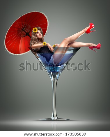 Concept. girl in martini glass with a red umbrella and yellow flowers. High resolution - stock photo