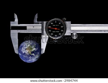 concept, globe in calipers - stock photo