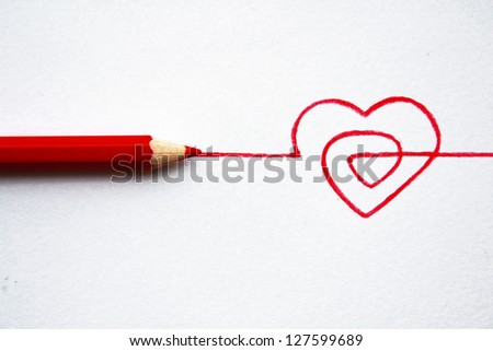 Concept hand drawn heart with pencils - stock photo