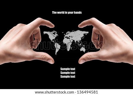 Concept. Hand with the map isolated on black background - stock photo