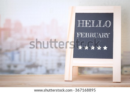 Concept HELLO FEBRUARY message on wood boards - stock photo