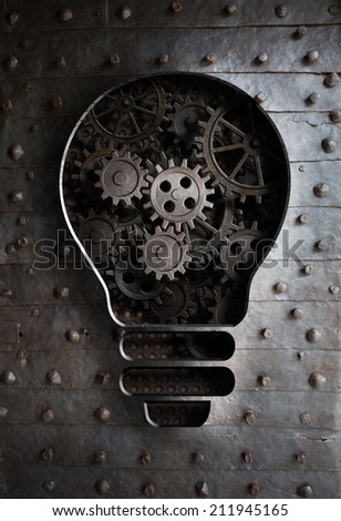 concept idea: bulb with working gears and cogs - stock photo