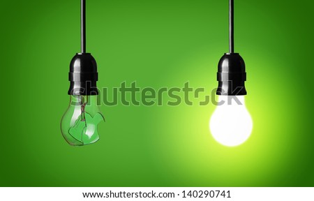 Concept idea with broken and glowing bulb