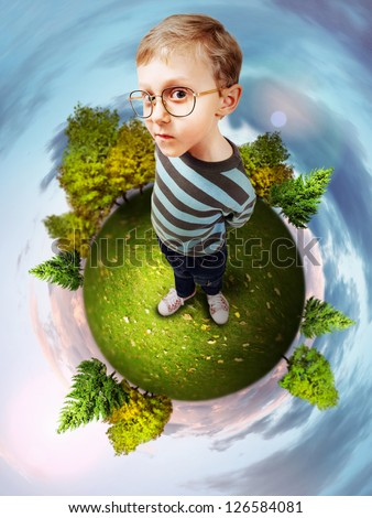 Concept image about green planet with clever little boy - stock photo