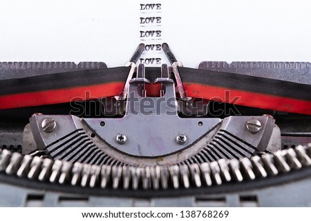 Concept image about Love written on an old typewriter . - stock photo