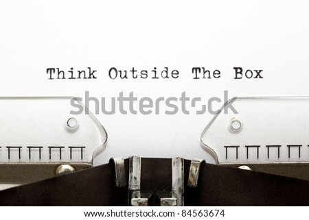 Concept image about unconventional or different thinking. THINK OUTSIDE THE BOX written on an old typewriter .