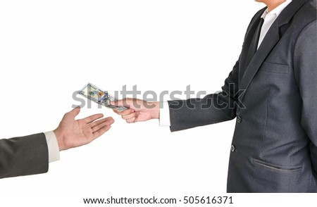 Concept image - corruption. Giving a bribe. Money in hand.