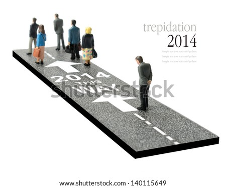 Concept image depicting a man showing some trepidation on the way to the year 2014. Will it be a better year or worse than 2013? Copy space. - stock photo