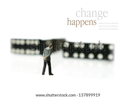 Concept image depicting change/domino effect. i.e. unemployment or retirement. Copy space. - stock photo