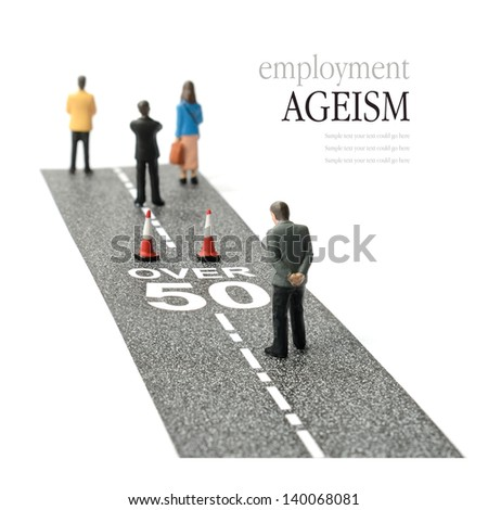 Concept image depicting employment ageism and discrimination for people over fifty. Selective focus on the road text. Copy space. - stock photo