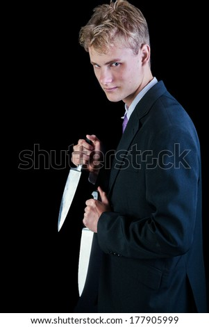 Concept image for corporate ruthlessness - showing man with knives drawn - stock photo