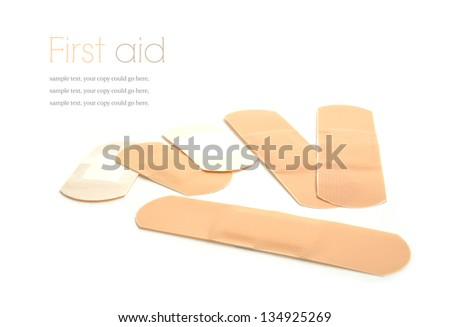 Concept image for first aid. Sterile plasters against a white background. Copy space. - stock photo