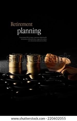 Concept image for retirement planning. Creatively lit golden coins with autumnal leaves representing older clients and their investments against a dark background. Copy space. - stock photo
